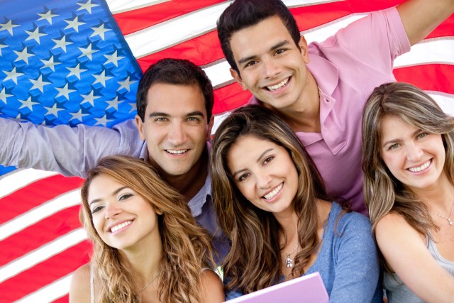 American youth in front of an American flag background