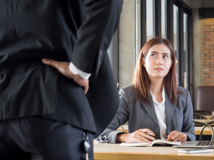 Female employee getting reprimanded by male boss