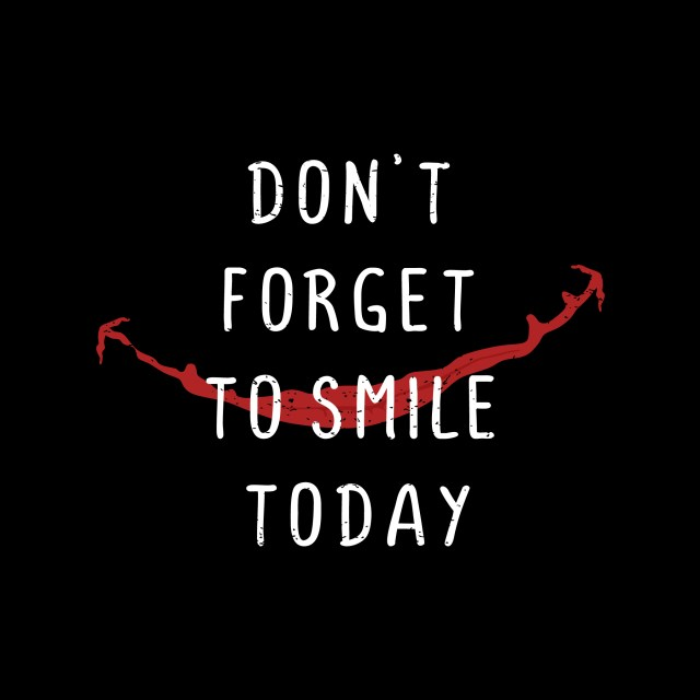 phrase don't forget to smile today with black background and red stitched smile