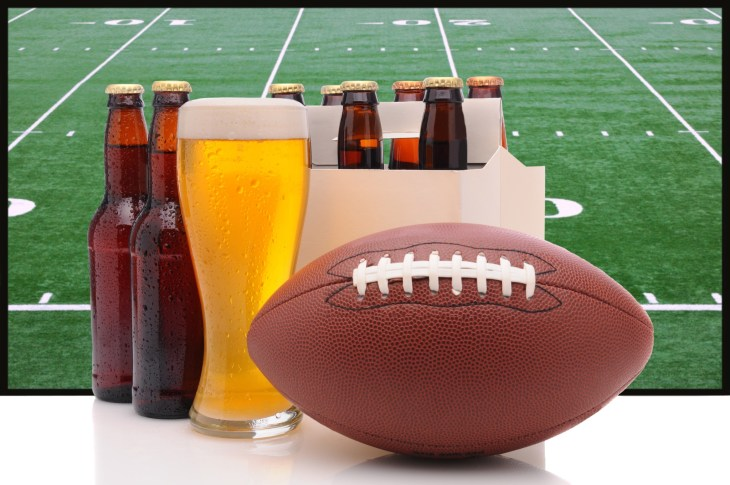 Football in front of many bear bottles and pints