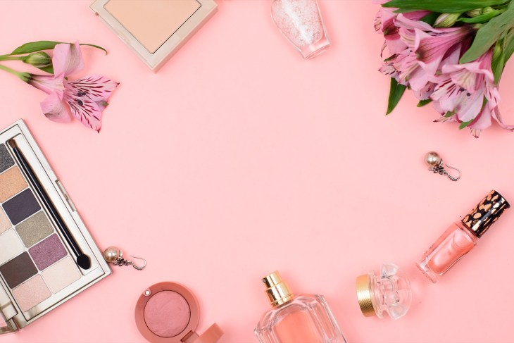 accessories and flowers on a pink background