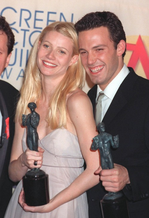 Gwyneth Paltrow and Ben Affleck holding their awards on the red carpet posing together