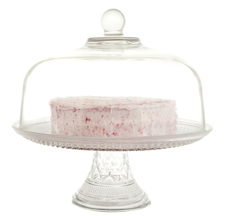 A cake inside of a glass stand.