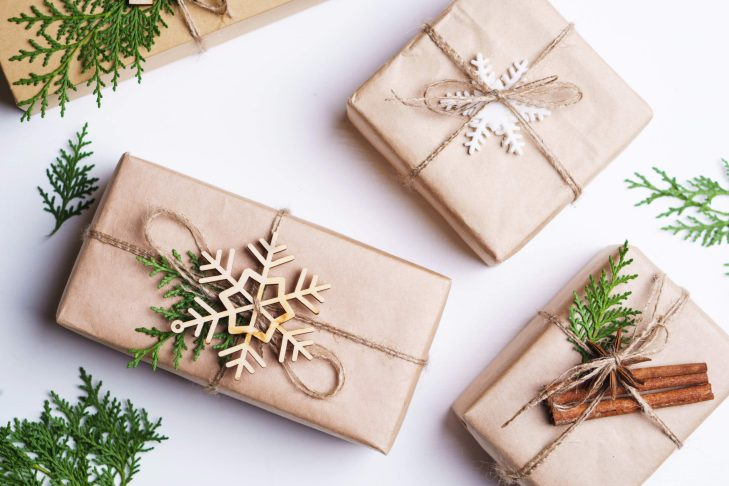 Wrapped presents with snowflakes on them.