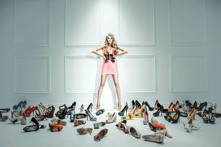 Woman With A Ton Of Shoes