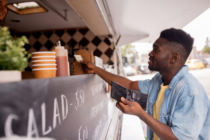 Young man paying for food