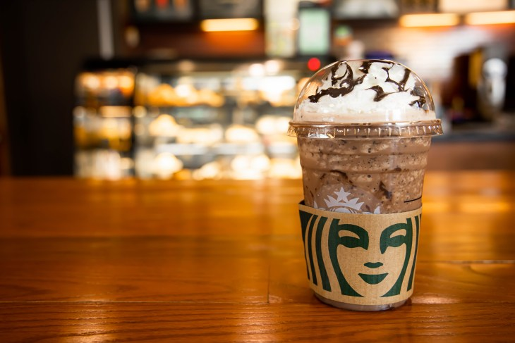 Mocha Cookie Crumble Frapp drink from Starbucks sitting on a table in a Starbucks