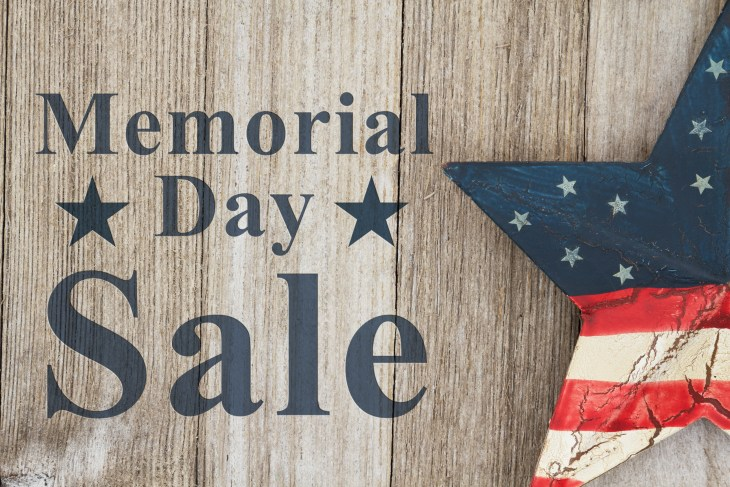 Memorial Day Sale sign on wood and with a big star that has the american flag on it