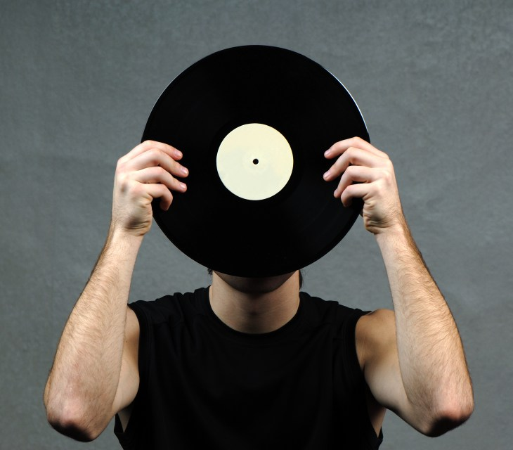 Someone holding a record up to their face
