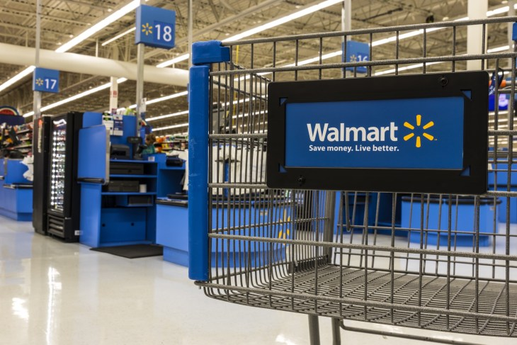 Foreground shot of Walmart shopping cart in store