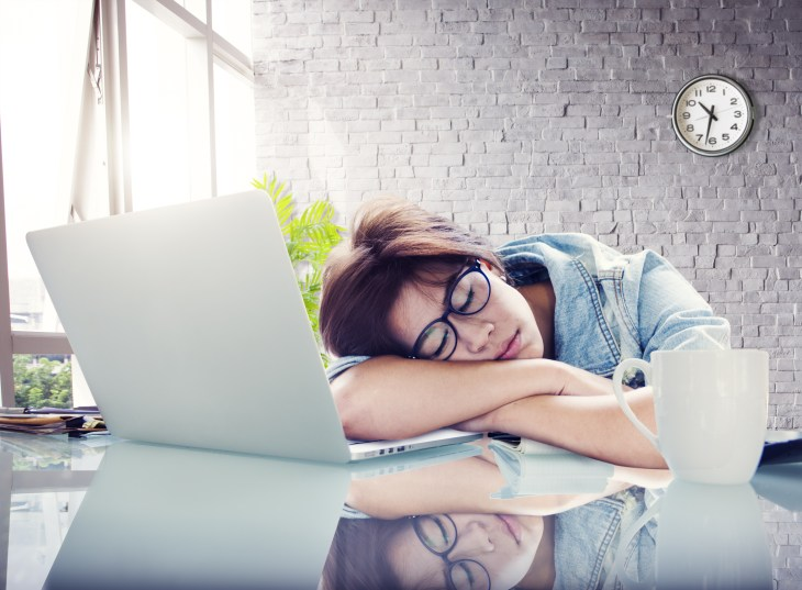 Woman taking a nap on her desk