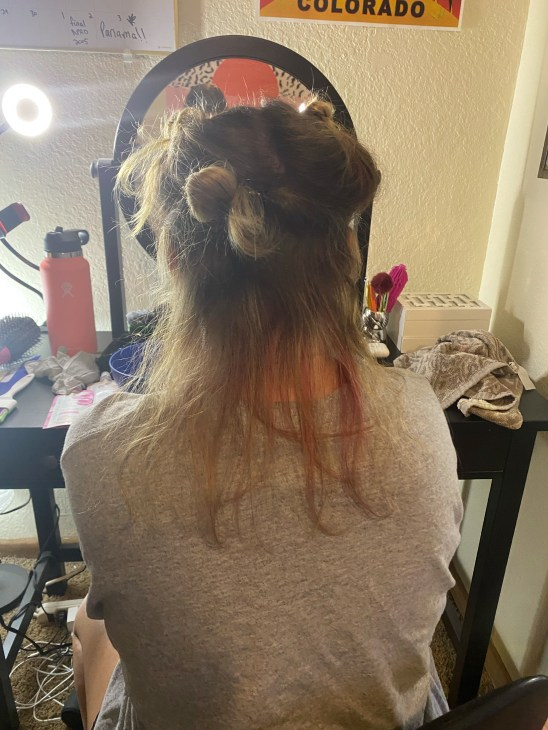 sectioned hair, sitting up, looking at the back of hair