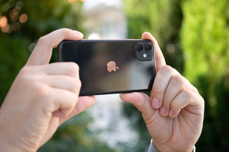 Someone holding up an iPhone