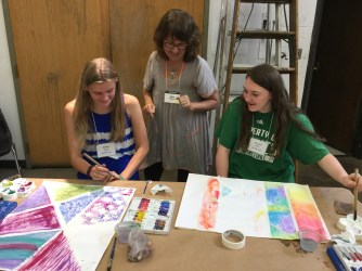 Kim sharing Watercolor techniques with her students.