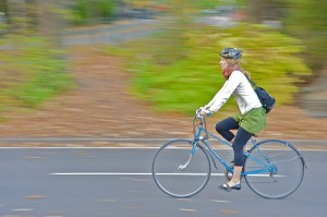Girl rides her bicycle