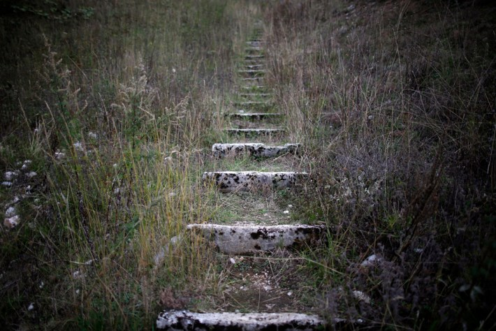 A view of worn stone steps which lead to the disused ski jump from the Sarajevo 1984 Winter Olympics on Mount Igman, near Saravejo