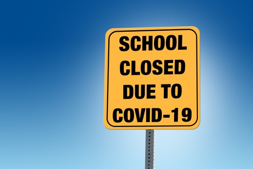 School Closed Due to COVID-19 sign with blue background