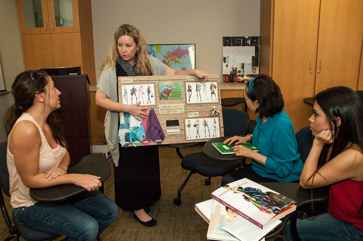 Course teaches students mixture of business  style  fashion on NE     Adjunct instructor