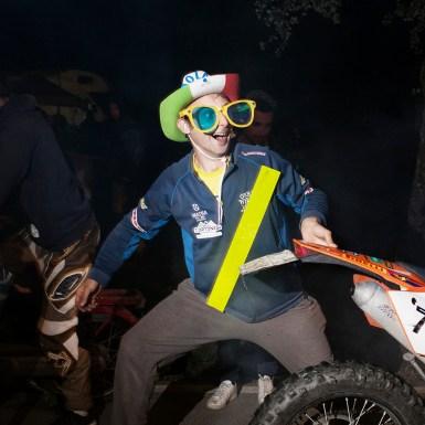 Scarperia (FI), maggio 2014. Un tifoso durante la festa la notte prima del motomondiale all'autodromo del Mugello. Scarperia (FI), May 2014. A fan at the evening party before the Grand Prix motorcycle racing at Mugello racetrack.