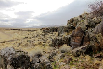 Basalt rim rocks surrounding the Petroglyph Lake