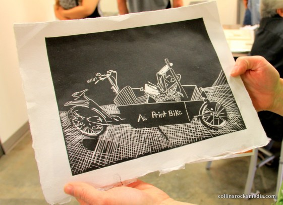 Julie Winter proudly shows her blueprint for a future A6 Gallery cargo bike