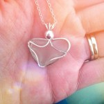 Day 17: In Your Hand.  A lovely heart necklace made out of beach glass for me by Aunt Cindy! :)