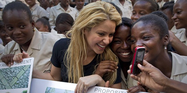 Colombian singer Shakira, center, has her picture taken with students at the Elie Dubois public school during a ceremony announcing the school's reconstruction project in Port-au-Prince, Haiti, Thursday, March 31, 2011. The Inter-American Development Bank and Shakira¿s Barefoot (Pies Descalzos) Foundation today announced they will support the Haitian government¿s efforts to rebuild the school with a $800.000 contribution. (AP Photo/Ramon Espinosa) APTOPIX Haiti Shakira APTOPIX_Haiti_Shakira_XRE114.jpg