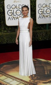 Alicia Vikander in Louis Vuitton This Swedish actress is fairly new to the red carpet game, but is already one of the most talked about and looked forward to of fashion critics. This Louis Vuitton dress gave off an Amish, apron-y vibe, but paired with simple hair and makeup, and two Golden Globe nominations, Vikander proved she was here to stay. Photo provided by the International Business Times.