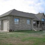brown limestone ledgerock house finished garage