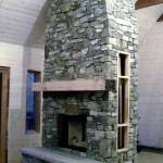 elite blue granite rustic fireplace