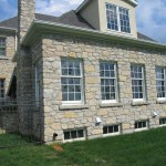 harvest gold limestone tumbled squared & ledgerock house side windows