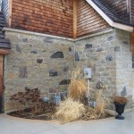 harvest gold limestone with granite house corner