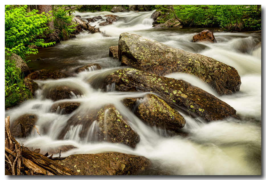 Cascading Water and Rocky Mountain Rocks