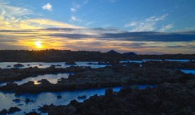Sunset over the Blue Lagoon, Iceland, where water used in geothermal energy production also sustains an amazing hot springs complex.