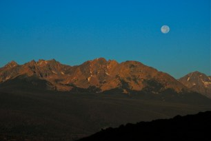 "The Aug. 2014 ""supermoon"" sets over the Gore Range, Summit County, Colorado."