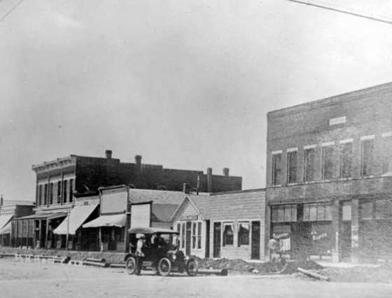 View along Main Street of first water main pipes being laid, 1912.