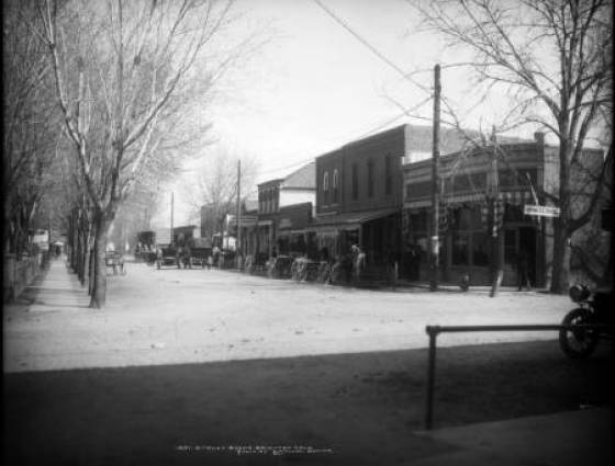 Brighton - Division Street, renamed North Main Street, shows businesses and early automobiles, 1908-1910