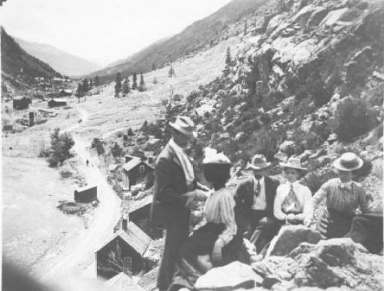 X-20866 McFadden & Hildebrand families have a picnic above town, 1900s.
