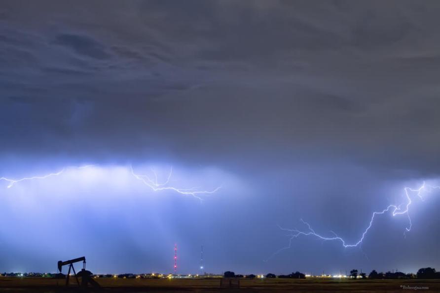 Lightning Strikes Above Oil Field Art Print