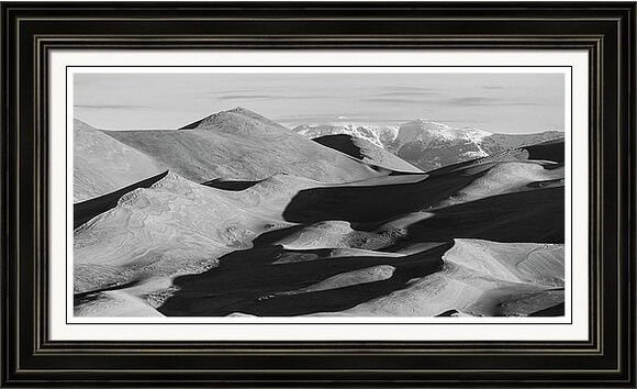 Monochrome Sand Dune Shadows And Rocky Mountains Panorama Framed Print
