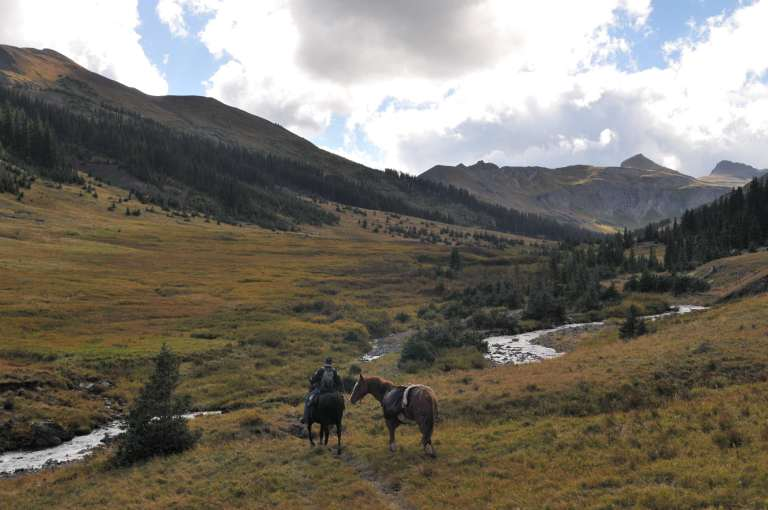 heading out on horseback