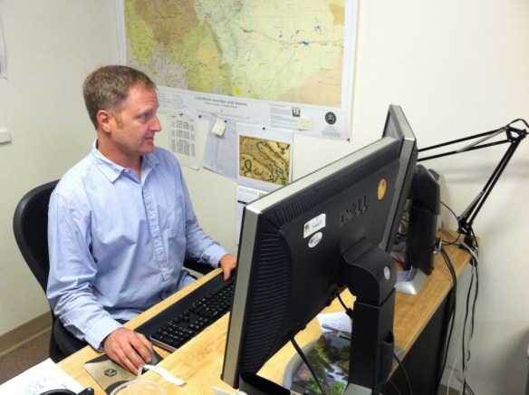 GIS Analyst Grant Wilcox works on developing the Colorado Fishing Atlas.