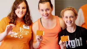 Students pose with their hunter education cards. Video capture by Jerry Neal/CPW.