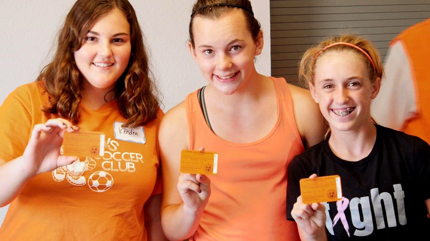 A group of youths pose with their hunter education cards. Video capture by Jerry Neal/CPW.