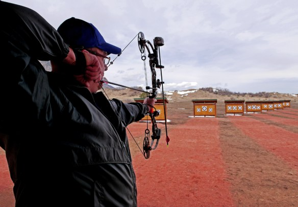 An archer takes aim on the competition-style shooting course. Photo by Jerry Neal/CPW.