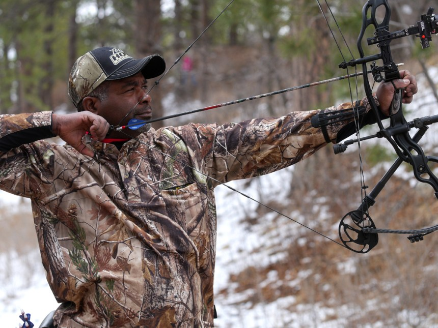A bowhunter shoots a compound bow on the 3-D range. Photo by Jerry Neal/CPW.