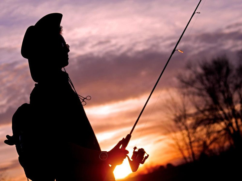 angler at sunset