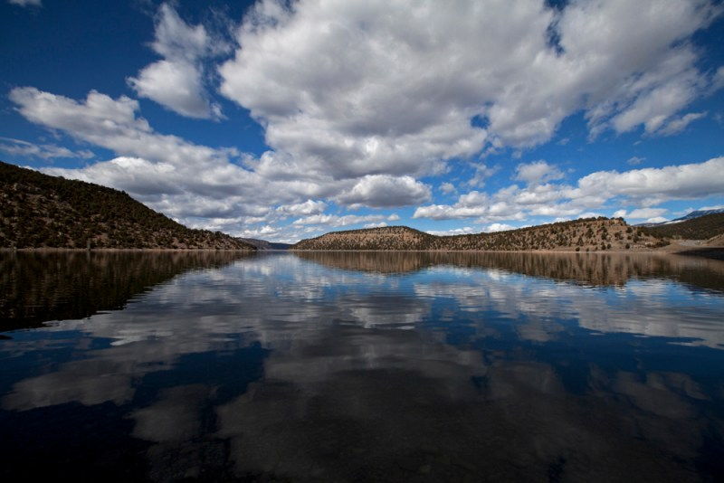 Clouds reflect off the surface of Ridgway Reservoir