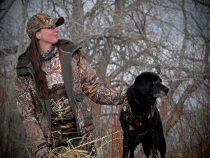 Hunter Cathy Brons and a black Lab. Photo by Jerry Neal/CPW.