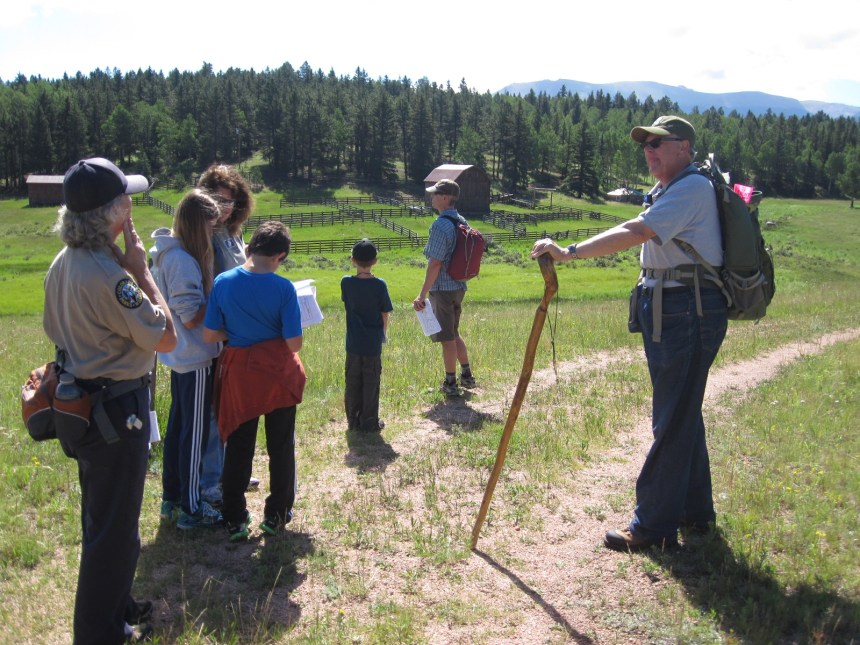Park volunteers guide visitors down one of Mueller's many hiking trails. Photo by Linda Groat.